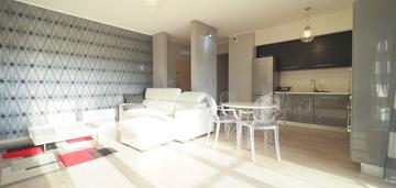 Apartament 54m2,taras, garaż, małe błonia eng
