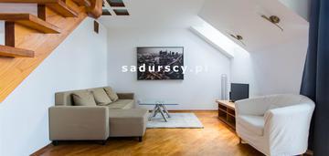 Dwupoziomowe mieszkanie z balkonem na klinach