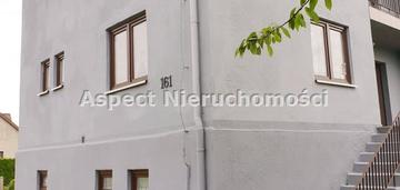 Przytulny dom z dużą działką w otoczeniu zieleni
