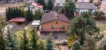Dom parterowy w czerwonaku 182 m2/1406 m2